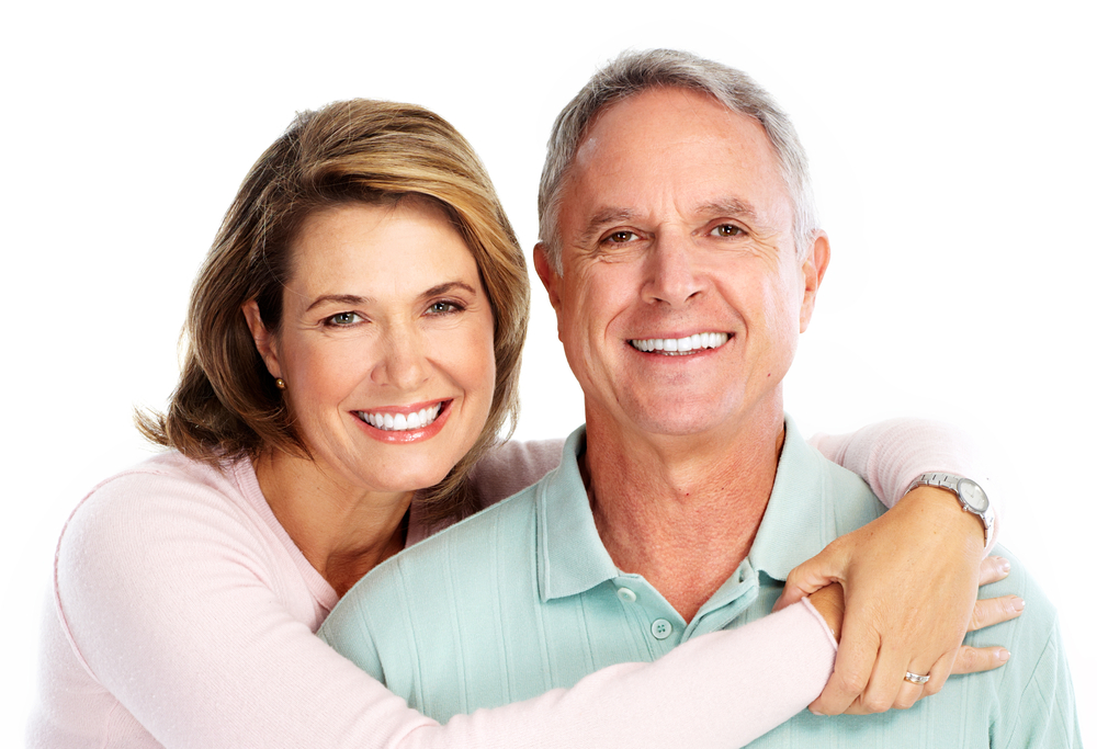 Older woman with her arms around man and smiling